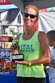 Debra Daly of Jensen Beach placed first among women in the Mutt March 5K run in Stuart.