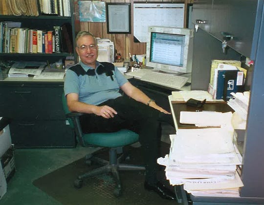 Roger Buckwalter in the Jupiter Courier office in 2001, the year he retired as editorial page editor.