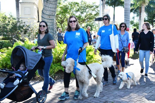 Humane Society of the Treasure Coast's Mutt March began with its traditional walk around Memorial Park in Stuart.