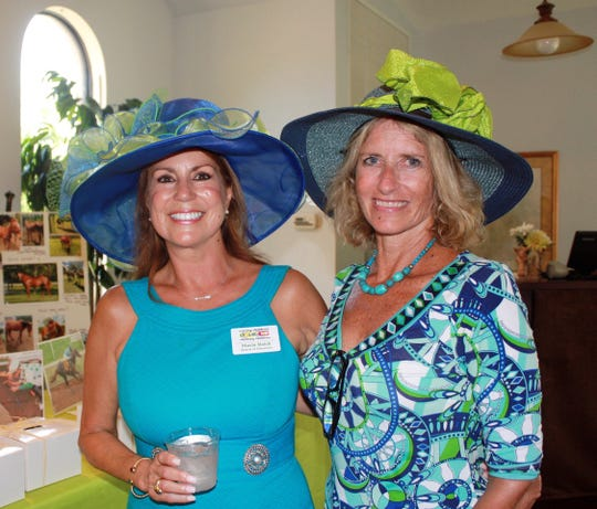 Caring Children Clothing Children Board member Maria Reich, left, and Executive Director Gigi Suntum wore Derby Day hats at the inaugural event in 2018.