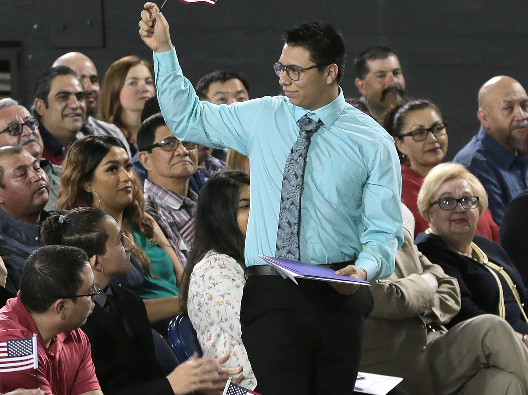 Miguel Perez was the youngest to receive his citizenship Thursday at a ceremony for 740 new citizens.