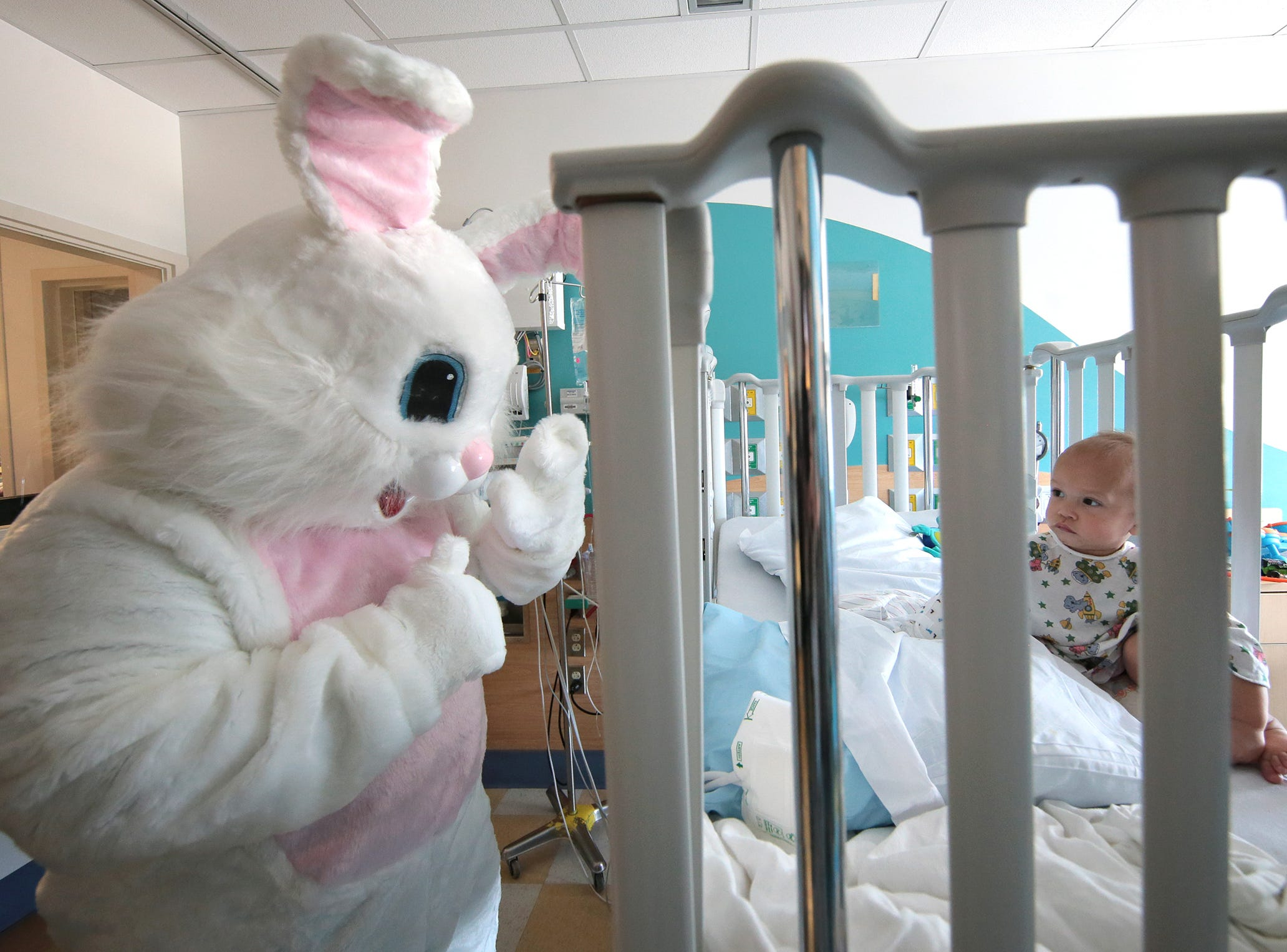 The Easter Bunny visits Liamsky Coonan, 1, in the ICU at El Paso Children's Hospital during a visit by the El Paso Sheriff's Office Thursday to deliver Easter baskets.