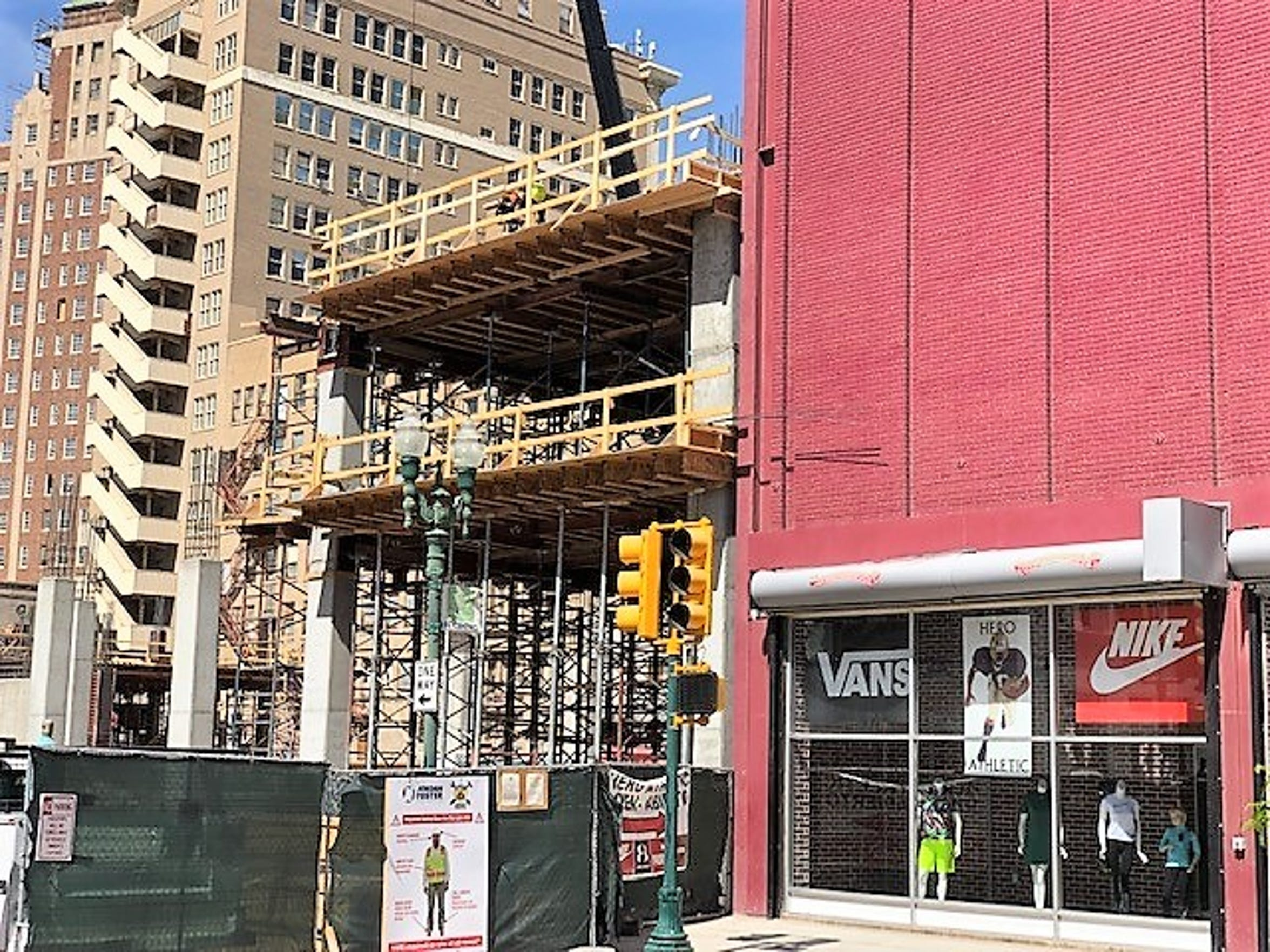 A portion of the Plaza Hotel parking garage is going up next to the Hero Athletic store on South El Paso Street in Downtown El Paso.