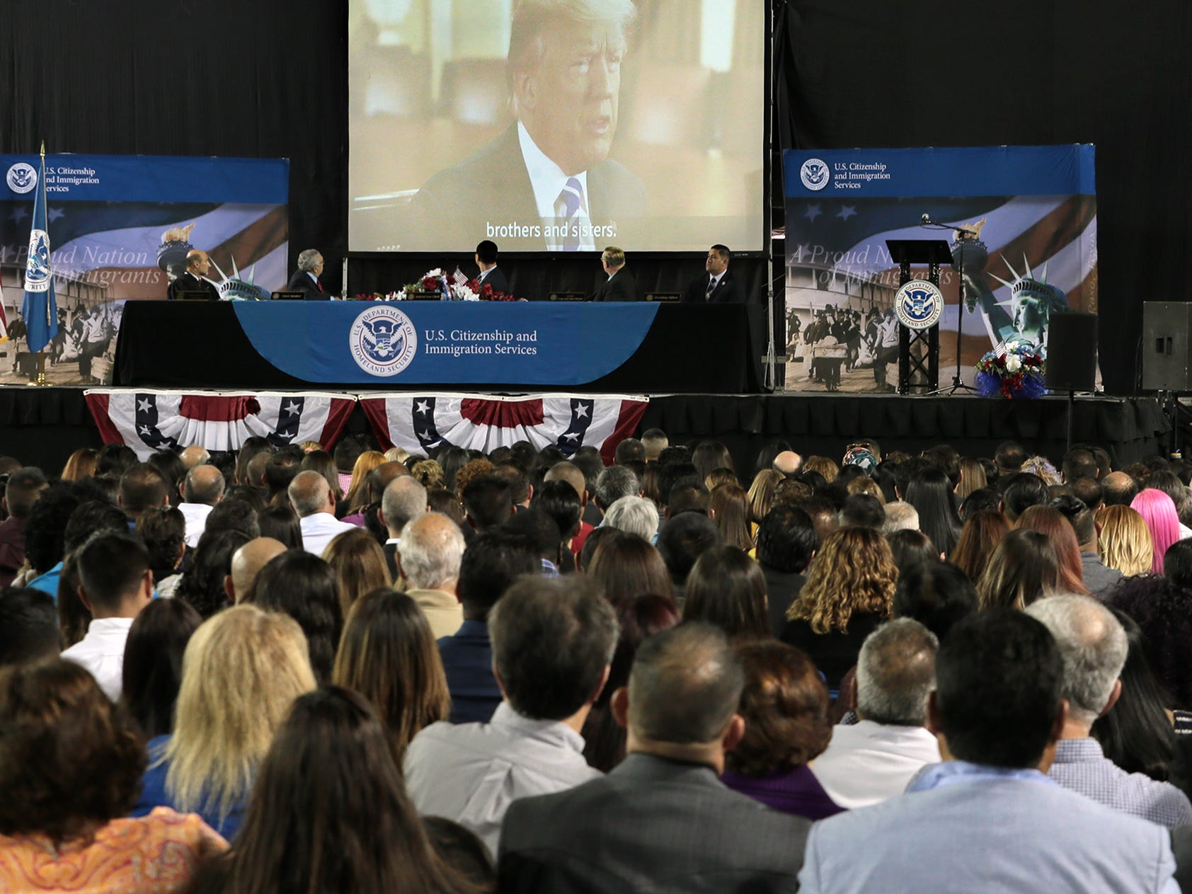 President Donald Trump addresses 740 new citizens Thursday at the El Paso County Coliseum.