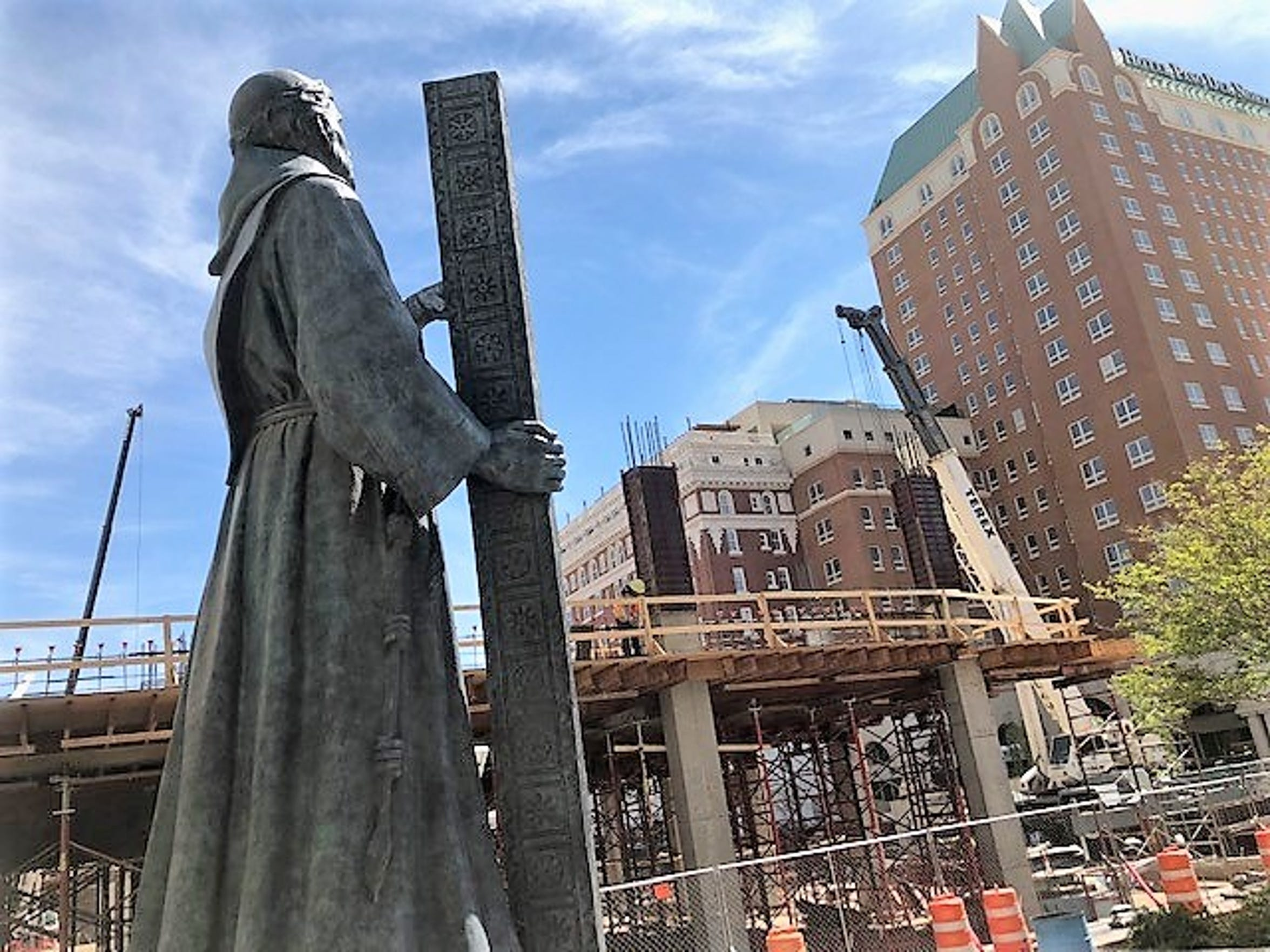 A statue of Fray Garcia de San Francisco, the priest that founded this area's first mission, stands in Pioneer Plaza, next to where the Plaza Hotel parking garage is being built in Downtown El Paso.