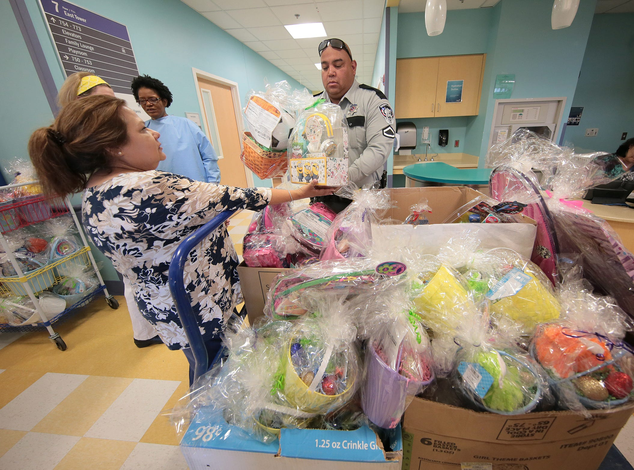 The El Paso Sheriff's Office along with Sheriff Richard Wiles and Easter Bunny visited kids at El Paso Children's Hospital Thursday.