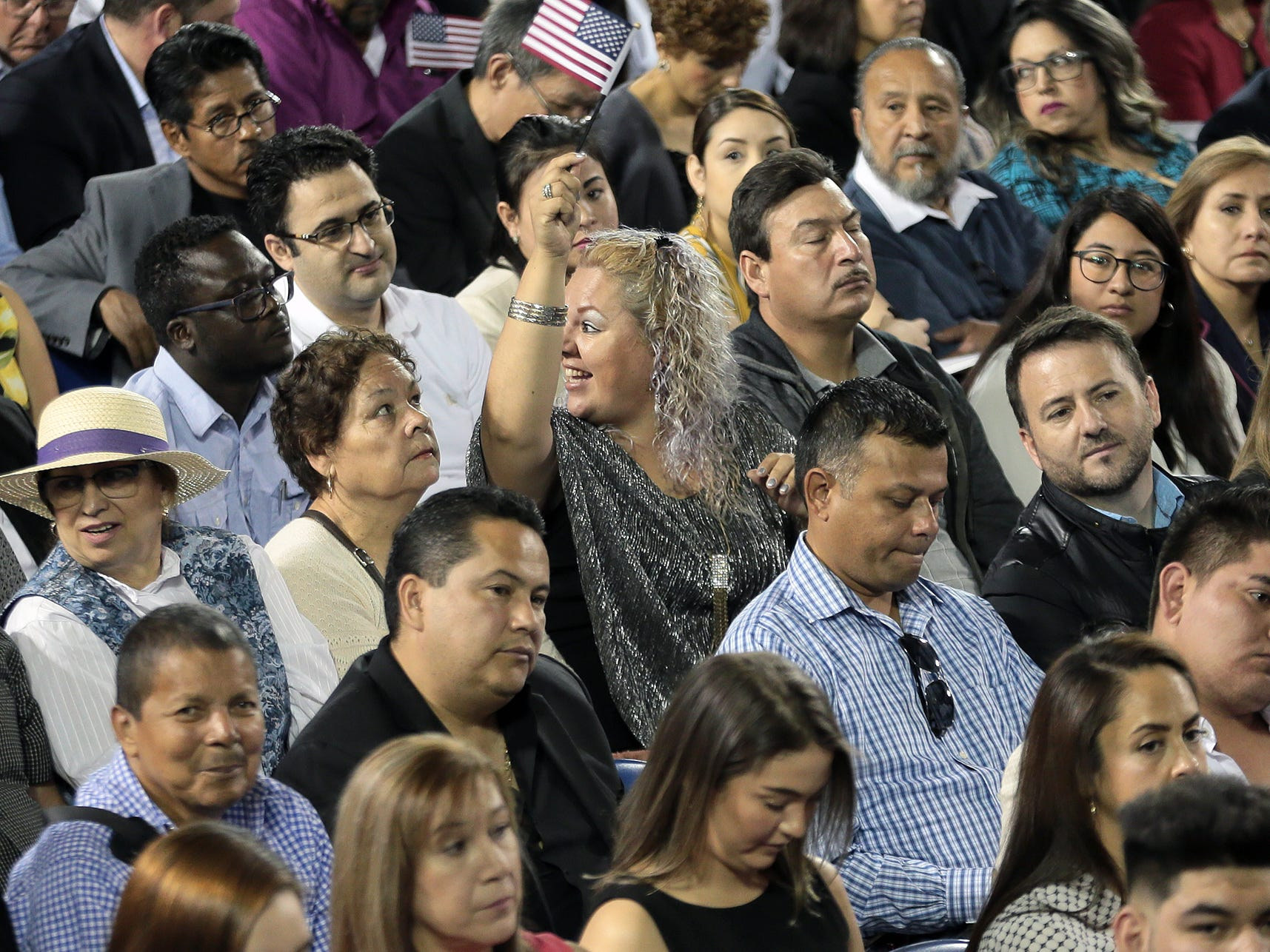 U.S. District Judge David C. Guaderrama administered the oath of citizenship to 740 new citizens Thursday at the El Paso County Coliseum.