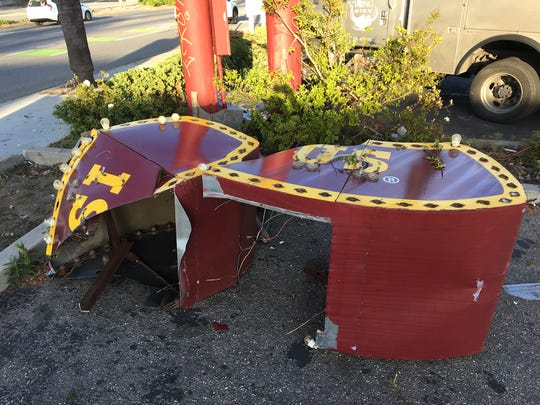 "The ""brim"" of the vintage hat-shaped Arby's sign that had been on display in Ventura since 1969 sits in pieces at the bottom of its pole mount on April 13, 2019."