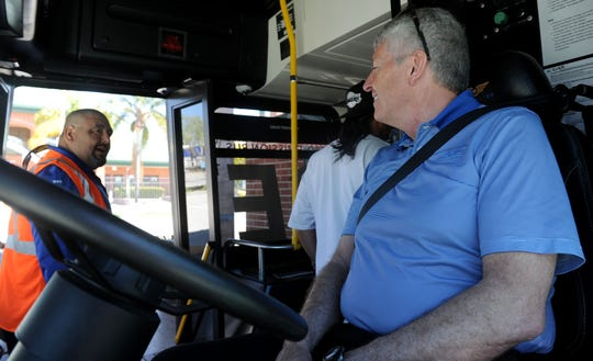 Manny Barrajas, left, bus operator for Gold Coast Transit District, gives Nate Schroder, a bus driver for New Flyer of America,  directions to Ventura.  Gold Coast Transit District was testing the all-electric bus Xcelsior Charge made by New Flyer on a route from Oxnard to Ventura.