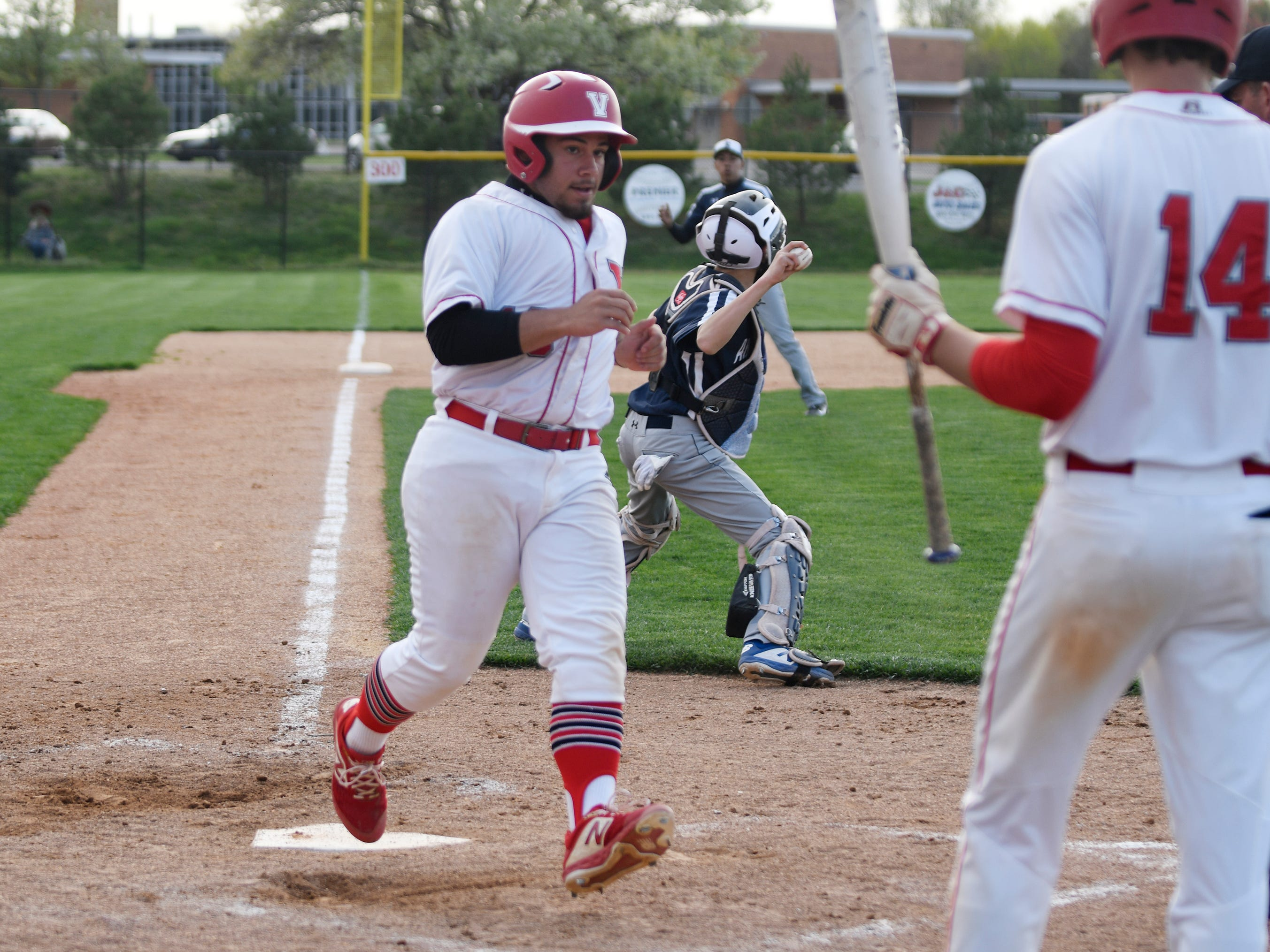 Vineland's Steven Gonzalez runs across home plate during a game against visiting Atlantic City on Wednesday. The Fighting Clan topped the Vikings 12-2.