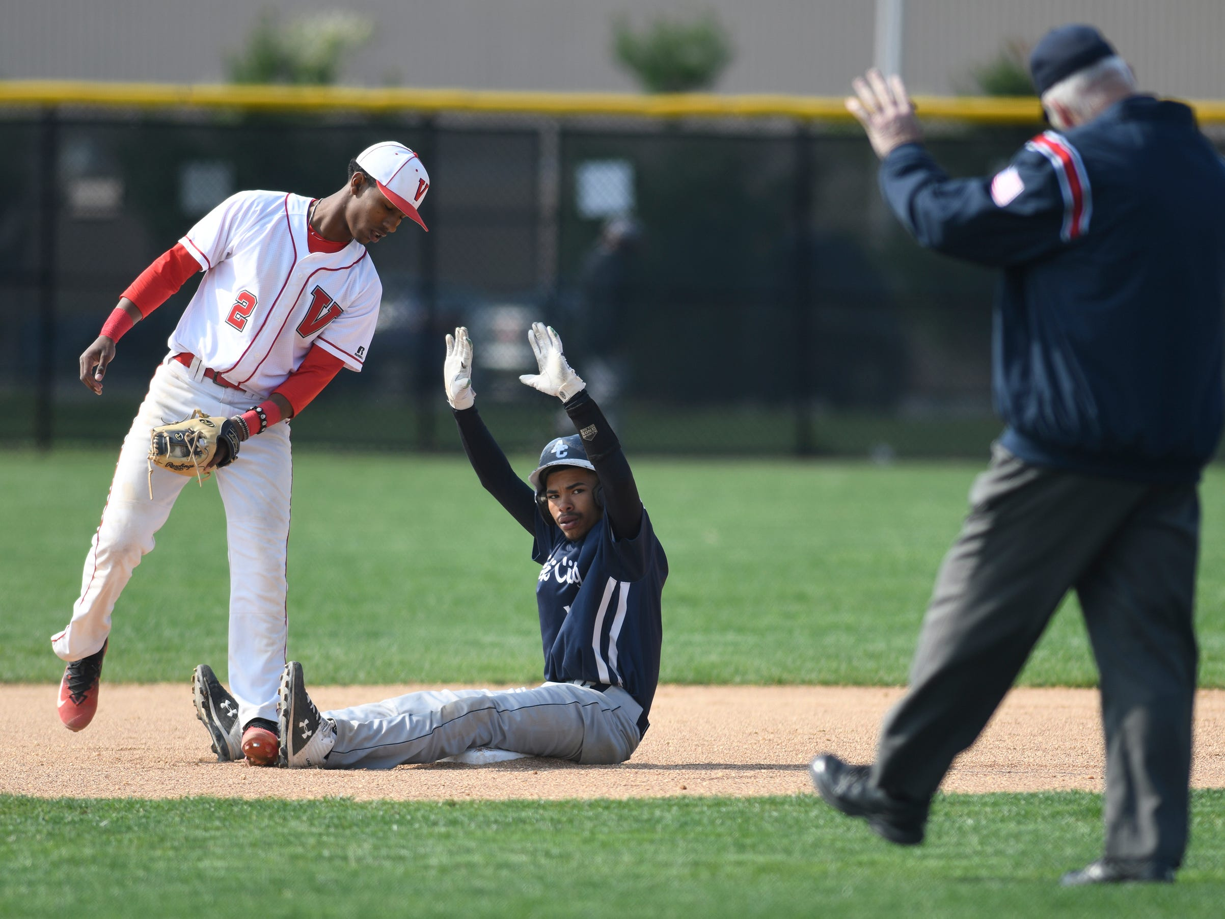 Vineland's Erv Bogan, left, plays second base during Wednesday's matchup against visiting Atlantic City. The Fighting Clan routed the Vikings 12-2.