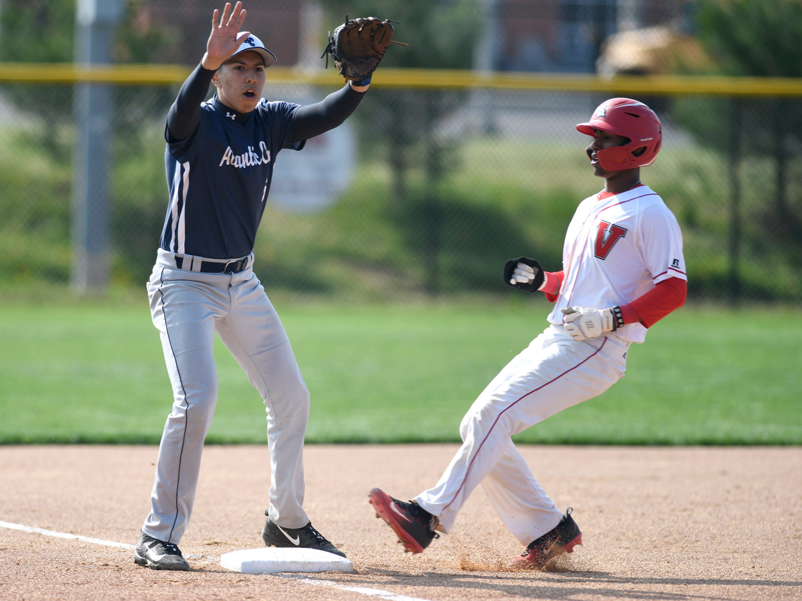 Vineland's Erv Bogan runs to third base during Wednesday's game against Atlantic City. The Fighting Clan dismantled the visiting Vikings 12-2.