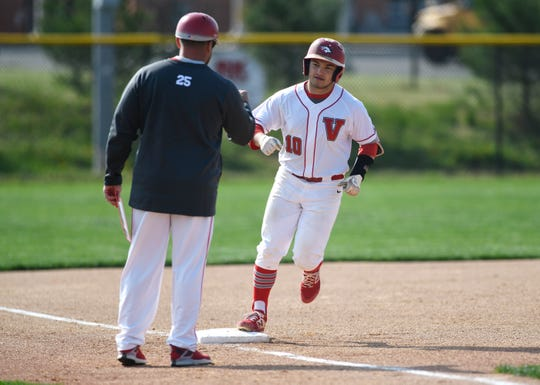 Vineland's Hector Perez rounds third after hitting a home run against visiting Atlantic City on Wednesday. The Fighting Clan topped the Vikings 12-2.