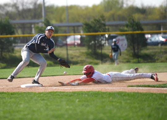 Vineland's Erv Bogan slides into third base during Wednesday's matchup against visiting Atlantic City. The Fighting Clan topped the Vikings 12-2.