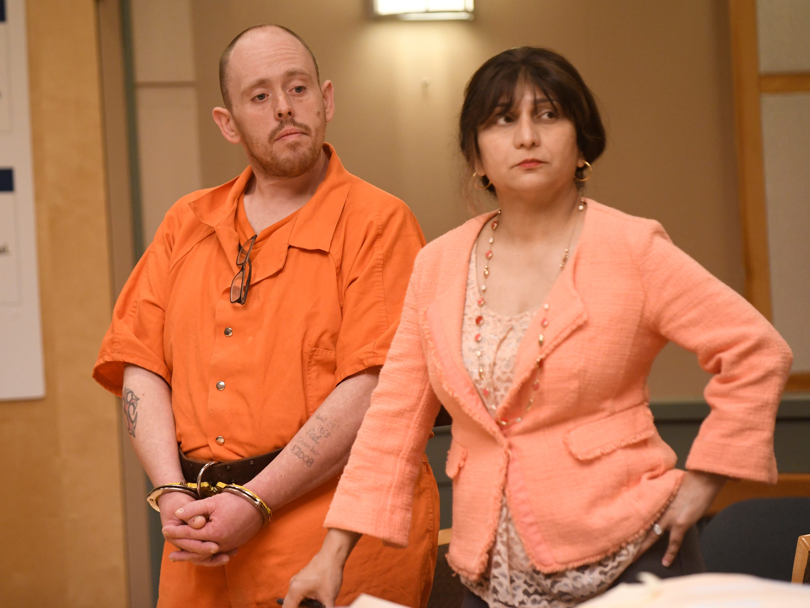 Leonard J. Zawojski and his defense attorney, Dinaz Akhtar, listen to Assistant Prosecutor Maghan Price in Cumberland County Superior Court on Thursday. Zawojski is charged with using a Taser to sexually assault a woman.