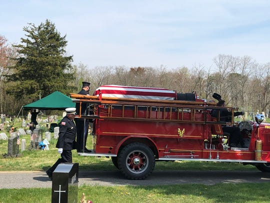 The flag-draped casket of retired Vineland Fire Company No. 2 Chief Joseph Letizia arrives at St. Mary's Cemetery on April 18, 2019.