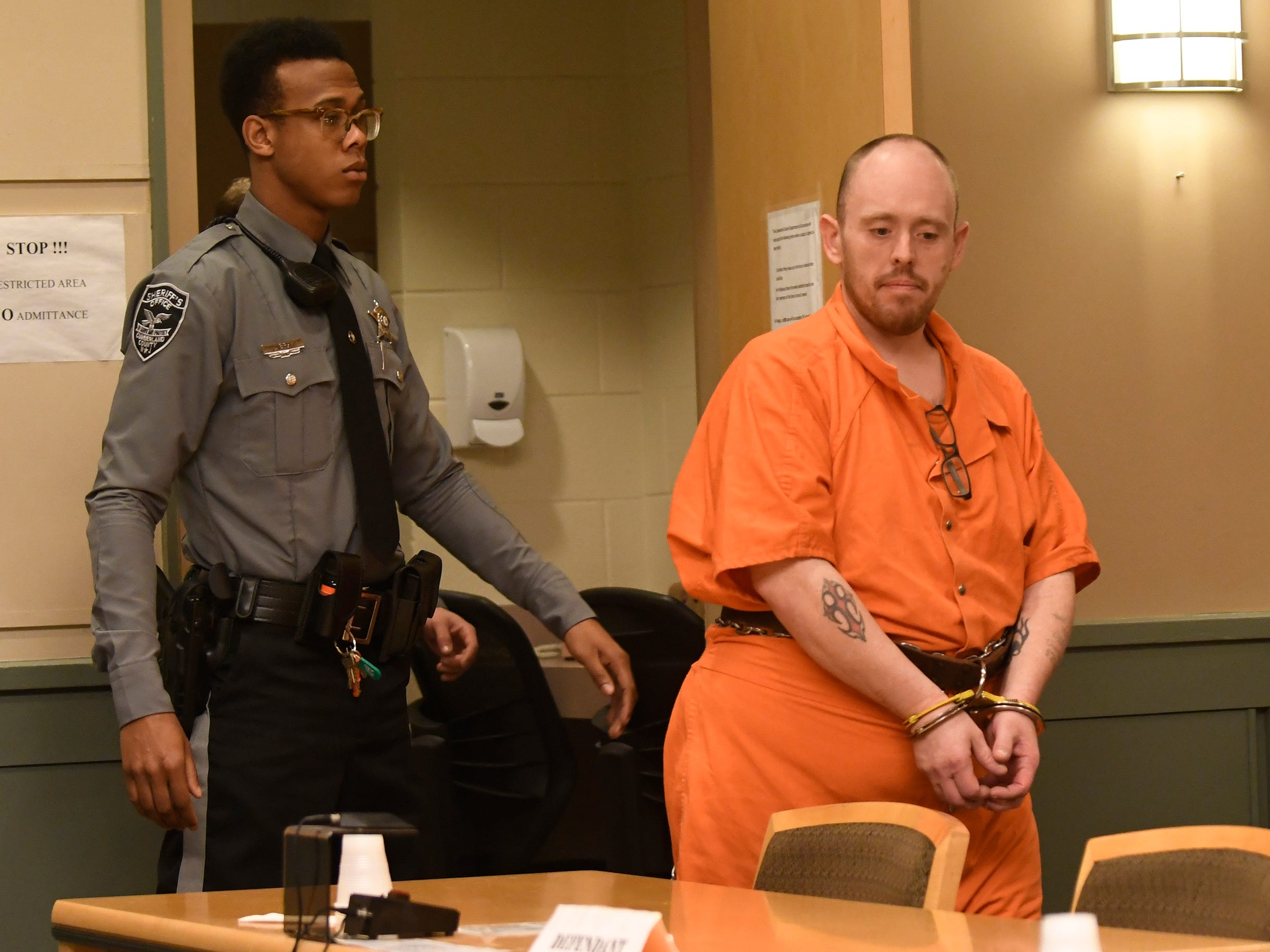 Leonard J. Zawojski stood in front of Judge Cristen D'Arrigo in Cumberland County Superior Court on Thursday. Zawojski is charged with using a Taser to sexually assault a woman in her Upper Deerfield home.