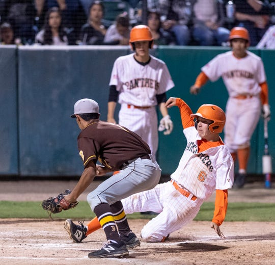 Porterville's Seth Correa sliced home safely ahead of the tag from Golden West's Matthew Gonzales in the 35th annual Tulare/Visalia Pro-PT Invitational upper-division championship baseball game at Recreation Park on Wednesday, April 17, 2019.