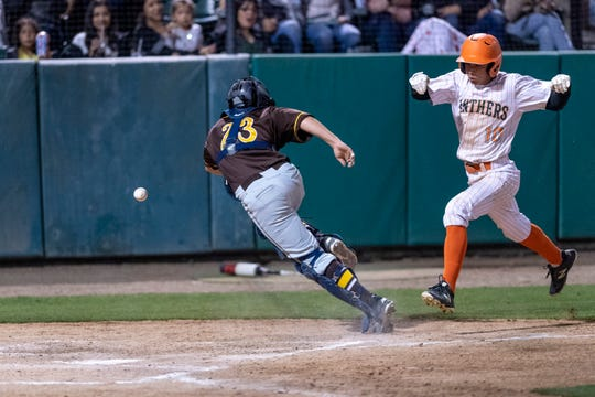 Porterville's Brandon Clingerman scores as Golden West's Andrew Delgado chases a wide throw in the 35th annual Tulare/Visalia Pro-PT Invitational upper-division championship baseball game at Recreation Park on Wednesday, April 17, 2019.