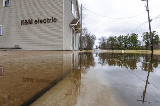 Flooding on Grand Avenue to K&M Electric in Schofield Thursday, April 18, 2019.