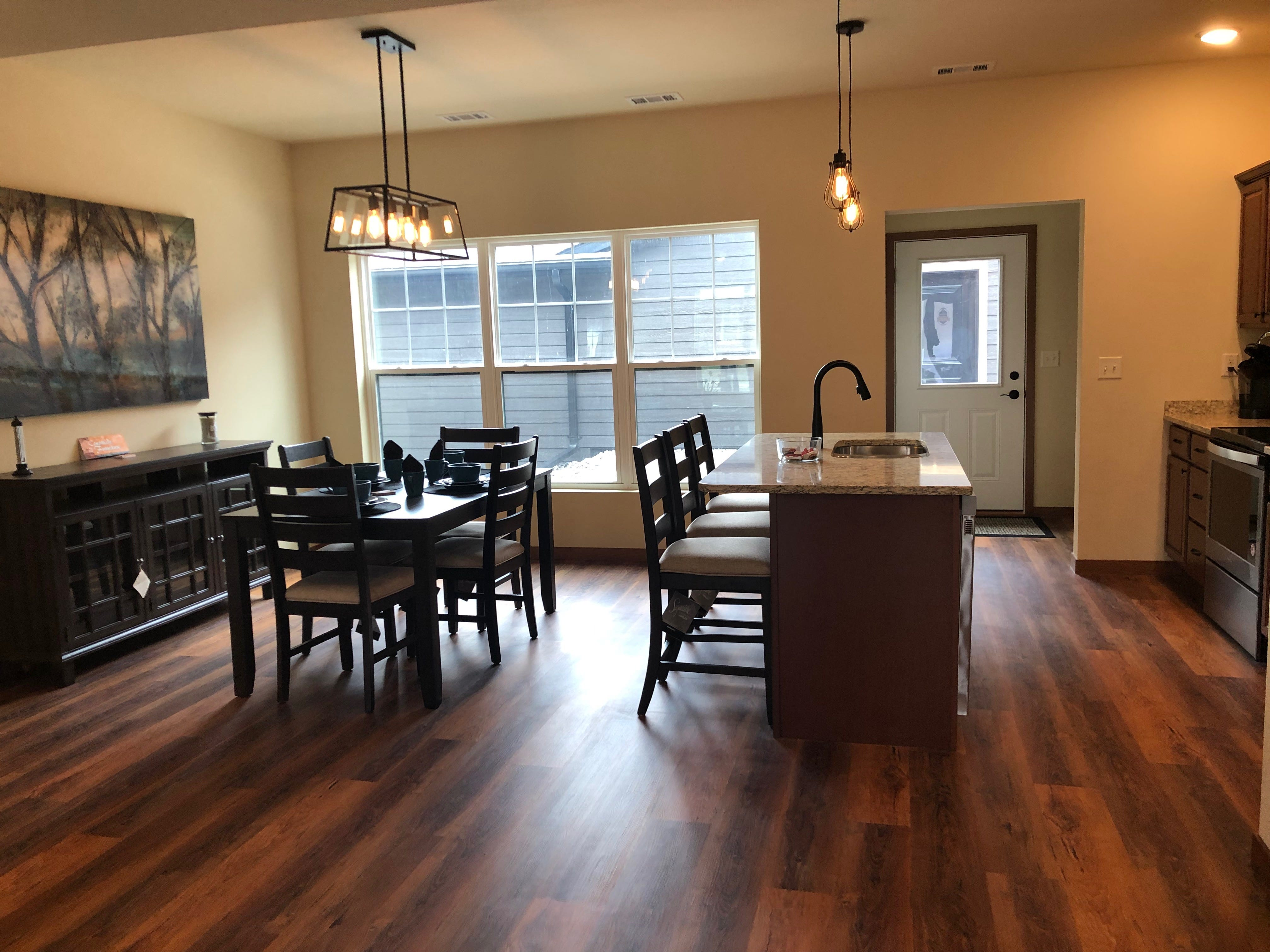 A staged kitchen and dining room in a River East Town Home on Third Street in Wausau.