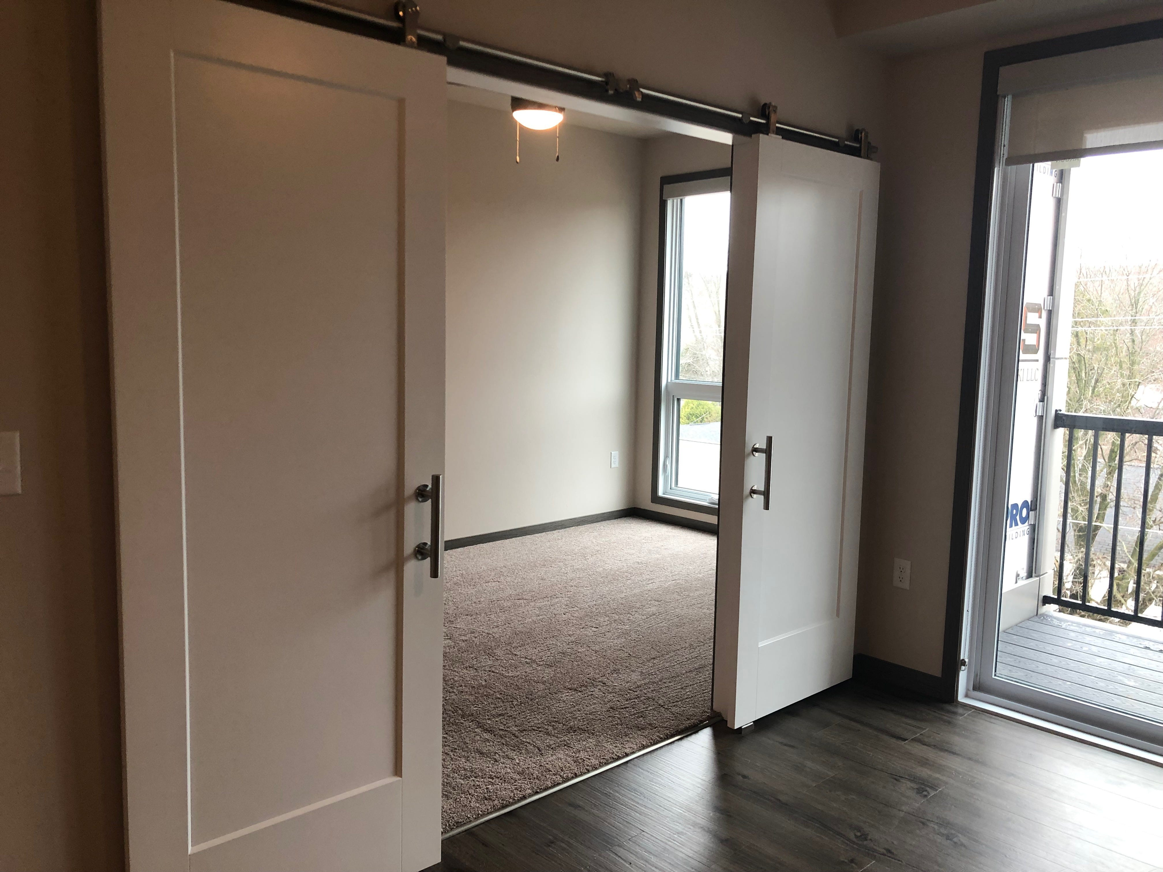 A studio apartment with a separated bedroom in the Urban West apartment complex.