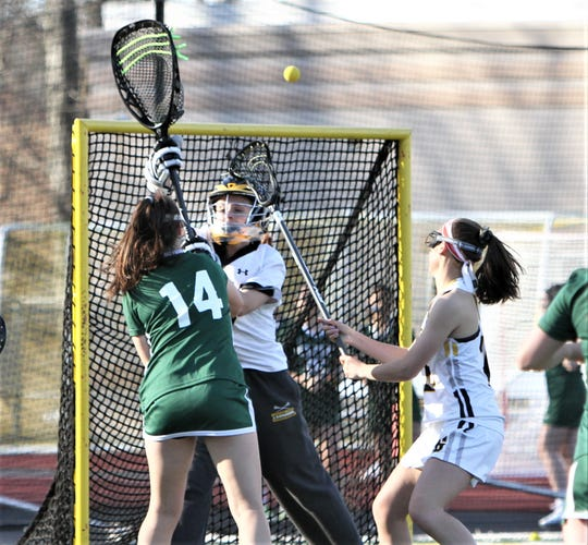 Lakeland-Panas goalie Miranda Lopes deflects shot by Yorktown's Alexa Borges over the net during April 17, 2019 game.