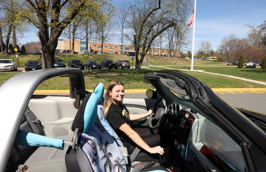 Scholar-athlete Lisa Clarke with her PT Cruiser that she bought herself and loves to work on, April 17, 2019 at Nanuet High School. Clarke will play field hockey for Pace next year.
