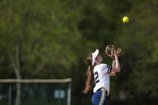 DMA's Samantha Freeland (22) catches a pop-up for an out against Caravel. Delaware Military Academy defeated Caravel Academy 7-3, on April 18.