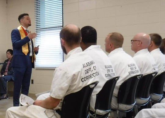 James Elliott speaks to inmates at the Alabama Department of Corrections earlier this week during their induction ceremony into the Phi Theta Kappa Honor Society. Elliott was elected president of the honor society last week. The 34 inmates study at Ingram State Technical College and are the first Phi Theta Kappa chapter comprised entirely of incarcerated members.