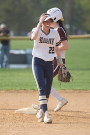 DMA's Samantha Freeland signals to a teammate Thursday afternoon against Caravel. Delaware Military Academy defeated Caravel Academy 7-3.