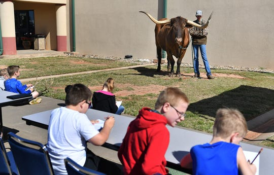 Students attending Texas Living History Day draw pictures of Rampage the Longhorn Thursday at Region 9 Education Service Center.