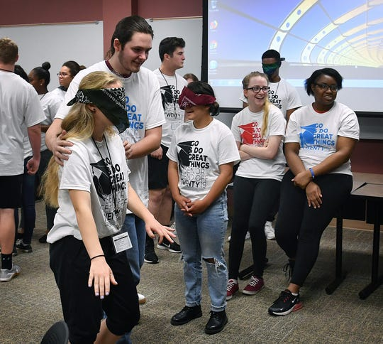 Blindfolded high students participate in an interactive team-building class at Midwestern State University during Senior Send-Off Day Thursday.