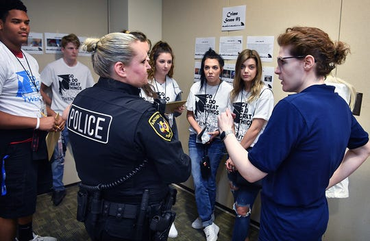 Archer City police officer Autumn Weber and presenter Sabrina Bradley answer questions for a group of high school students considering a career in law enforcement Thursday morning during Senior Send-Off Day at Midwestern State University.