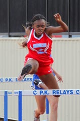 Hirschi's Jaelyn Washington runs to a first-place finish in the girls 100 hurdles on Wednesday.