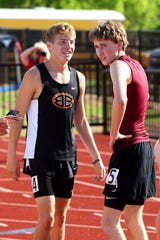 Burkburnett's Sloan Lewis and Vernon's Riley Elliott discuss their race after running the  mile Wednesday at the 5/6-4A Area Meet.