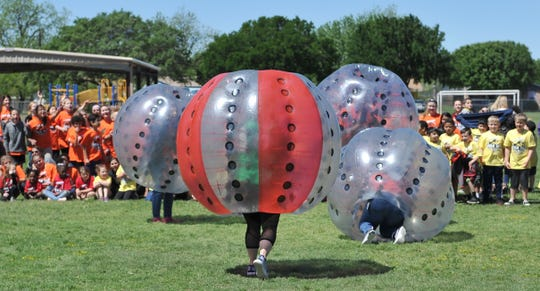 Ben Milam Elementary students watched as the school's teachers and staff battled it out in Battle Ball, Thursday morning. The Wichita Falls Battle Ball will soon be changing hands when it becomes part of Jump for Joy.