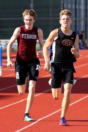 Burkburnett's Sloan Lewis and Vernon's Riley Elliott battle for first in the mile Wednesday at the 5/6-4A Area Meet.