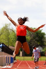 Burkburnett freshman Tania Lee jumps to a first-place finish with a jump of 17-7 Wednesday at the Area 5/6-4A Meet. Lee also led all three relays to regional appearances.