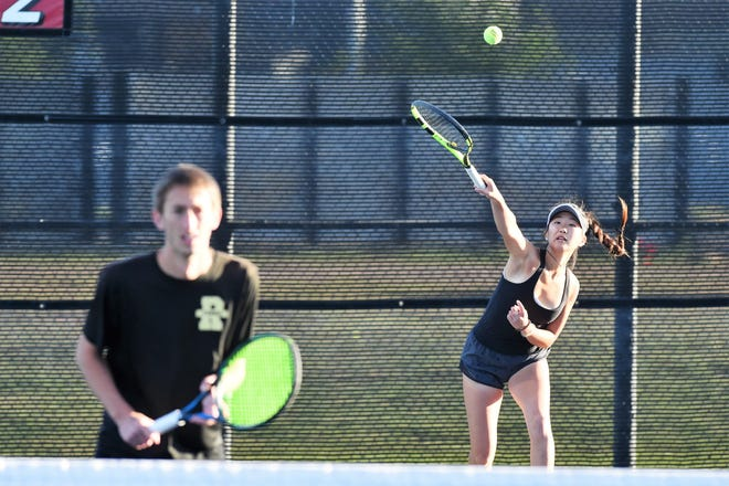 Rider's Chris Selsor (left) and Julia Chon advanced to state Thursday by winning a playback to finish second at the Region I-5A Tournament in Lubbock.