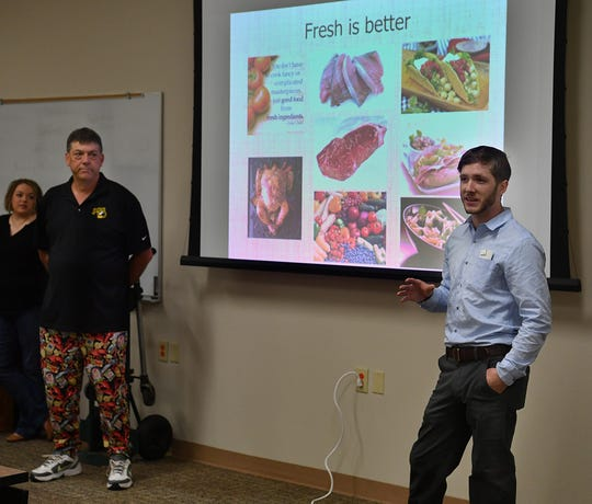 Chef Patrick Street, right, and restauranteur Scott Plowman present a look at grocery shopping, meal preparation and the food service industry during Senior Send-Off Day Thursday.