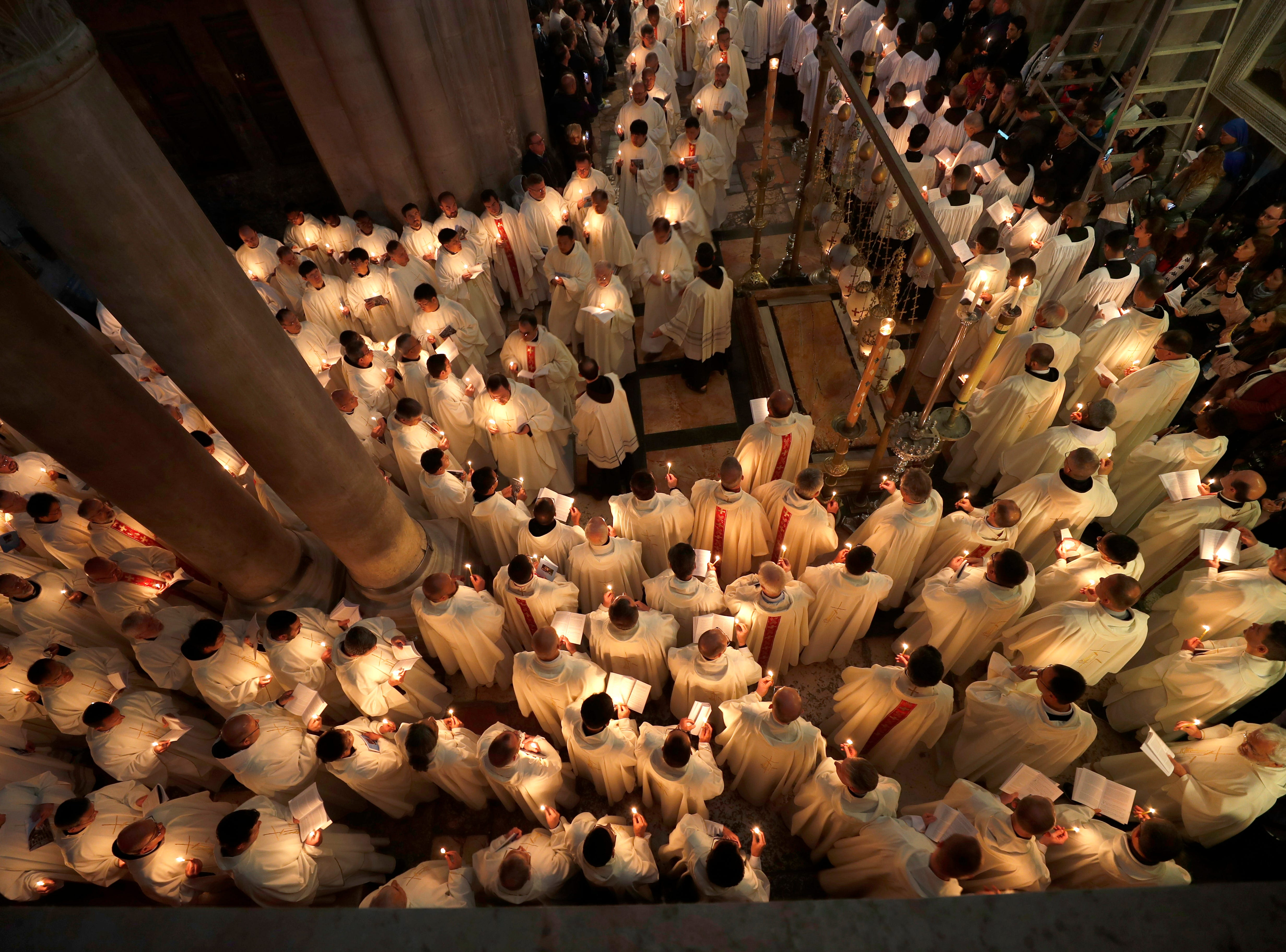 Christian worshippers take part in the procession of the holy Thursday, during the Catholic Washing of the Feet ceremony on Easter Holy Week, at the Church of the Holy Sepulcher in Jerusalem's old city on April 18, 2019.