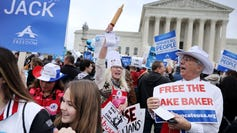 Demonstrators rallied in front of the Supreme Court in December 2017, when the justices heard the case of Masterpiece Cakeshop owner Jack Phillips' refusal to create a cake for a gay couple's wedding celebration.