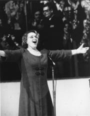"Kate Smith sings ""God Bless America"" on May 19, 1974, before Game 6 of the Stanley Cup Final between the Philadelphia Flyers and Boston Bruins."