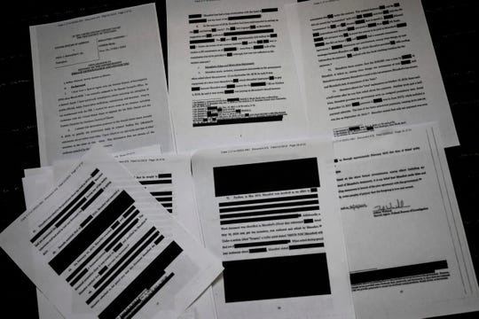 A redacted court filing from special counsel Robert Mueller in the Paul Manafort case is viewed on April 16, 2019.