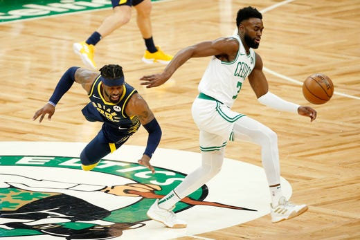 April 17: Indiana guard Wesley Matthews (23) battles for a loose ball with Boston  guard Jaylen Brown (7) during Game 2. The Celtics rallied to beat the Pacers 99-91.