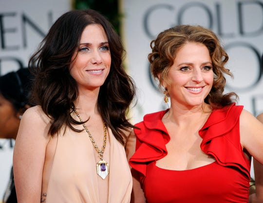 Kristen Wiig, left, and Annie Mumolo at the Golden Globe Awards in Los Angeles  on Jan. 15, 2012.