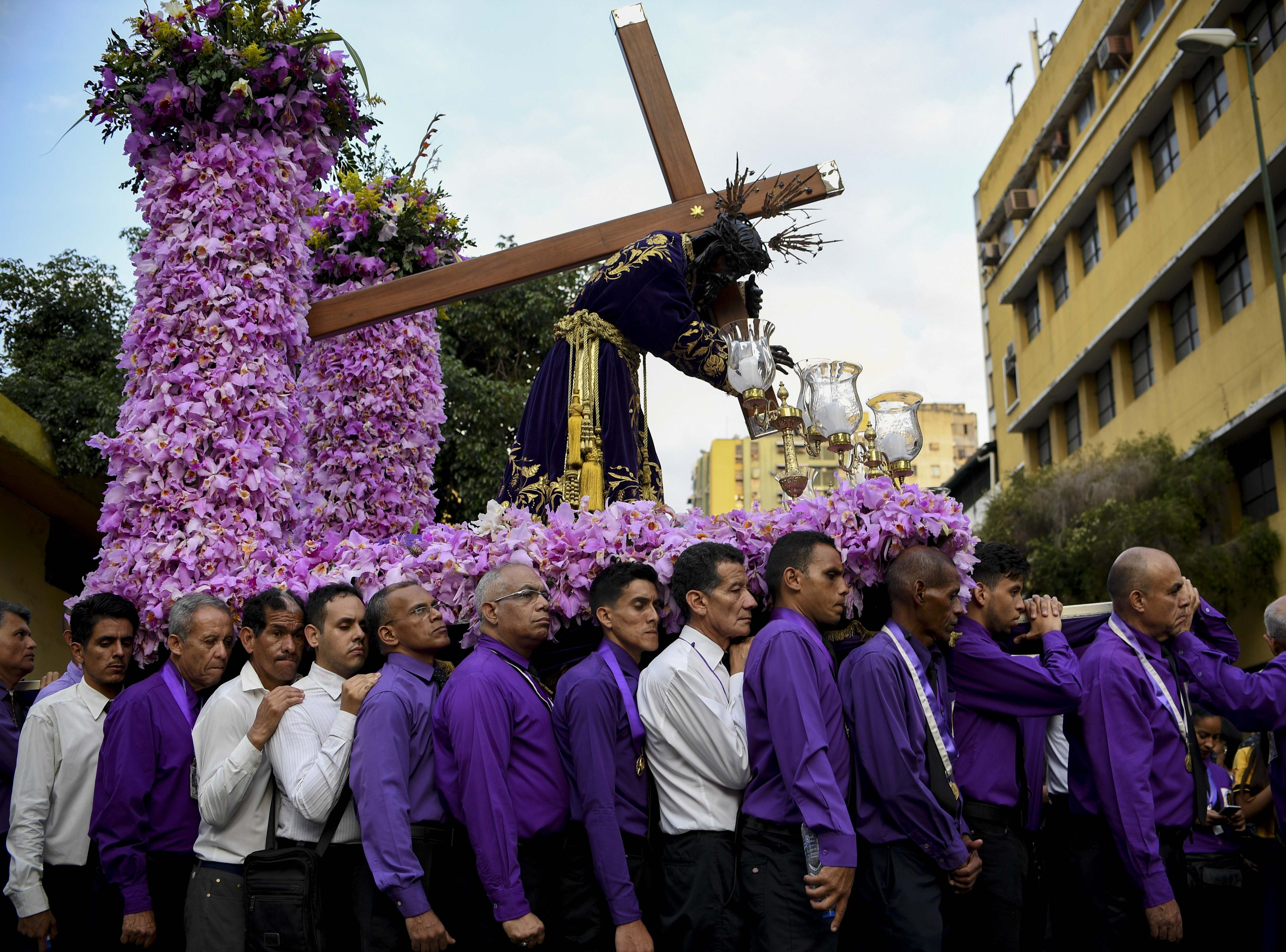 Catholic faithfuls take part in the traditional Nazareno de San Pablo (Saint Paul's Nazarene) procession in the framework of Holy Week celebrations in Caracas, on April 17, 2019.