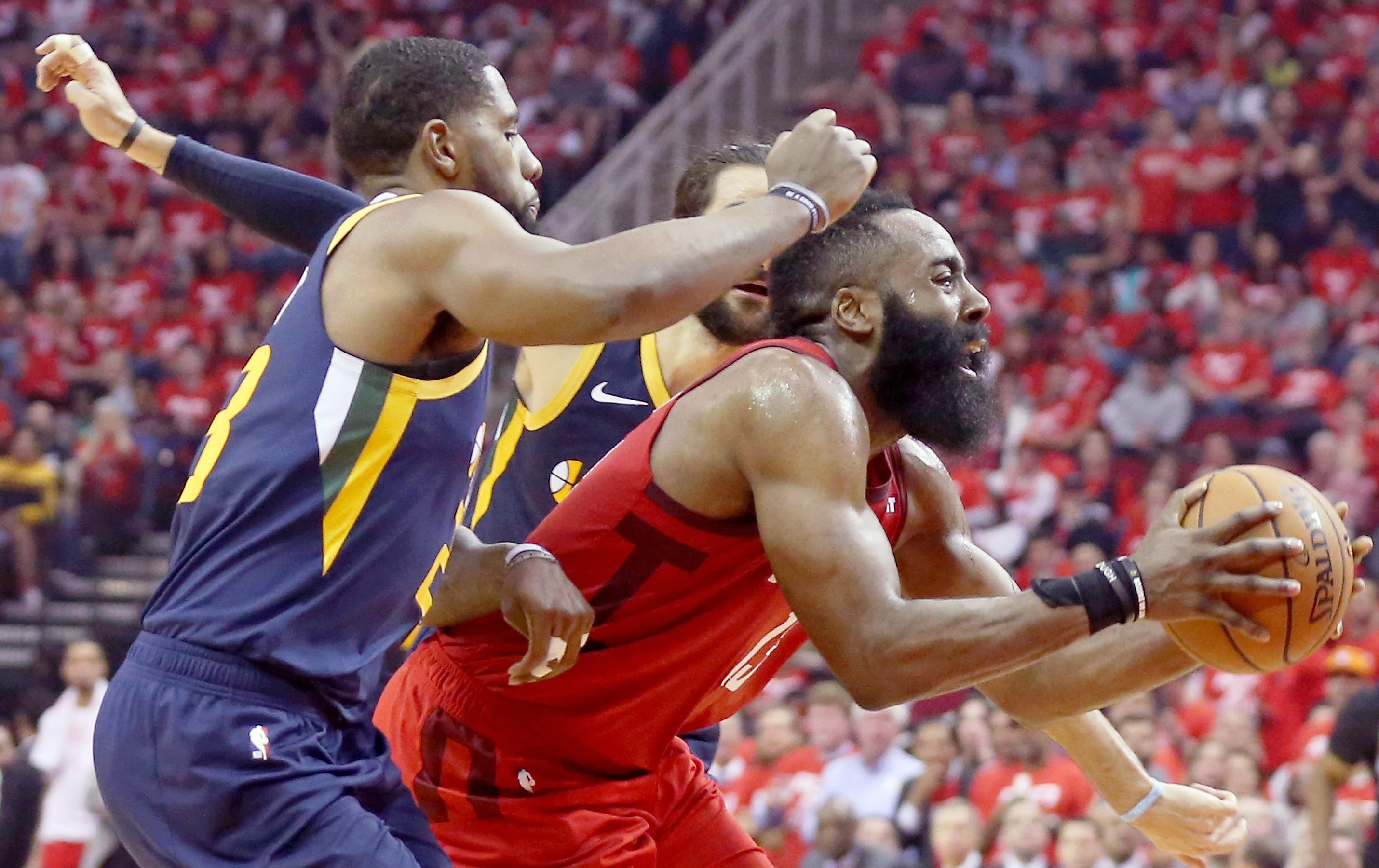April 17: Houston Rockets guard James Harden is defended by the Utah Jazz in the first half of Game 2 at Toyota Center. The Rockets won the game, 118-98.