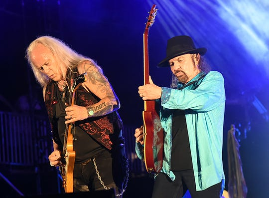 Lynyrd Skynyrd guitarists Rickey Medlocke, left, and Gary Rossington playing in Florida last fall.